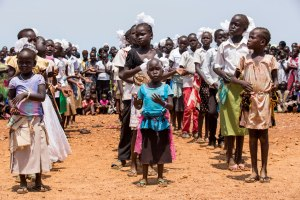 Children at a protection of civilians site in Juba, South Sudan, run by the UN Mission, perform at a special cultural event in March 2015. UN Photo/JC McIlwaine